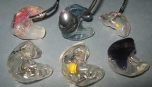 Several custom in-ear monitors